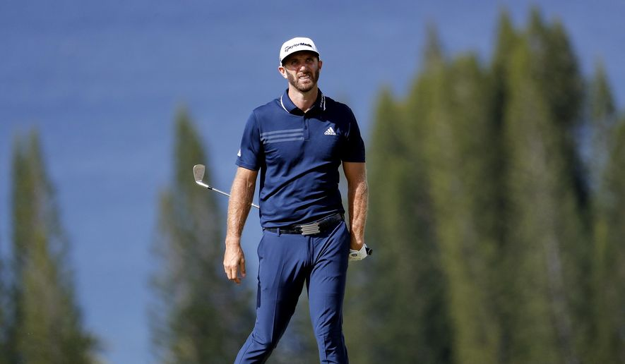 Dustin Johnson watches his approach shot take flight on the fourth fairway during the final round of the Tournament of Champions golf event, Sunday, Jan. 7, 2018, at Kapalua Plantation Course in Kapalua, Hawaii. (AP Photo/Matt York)