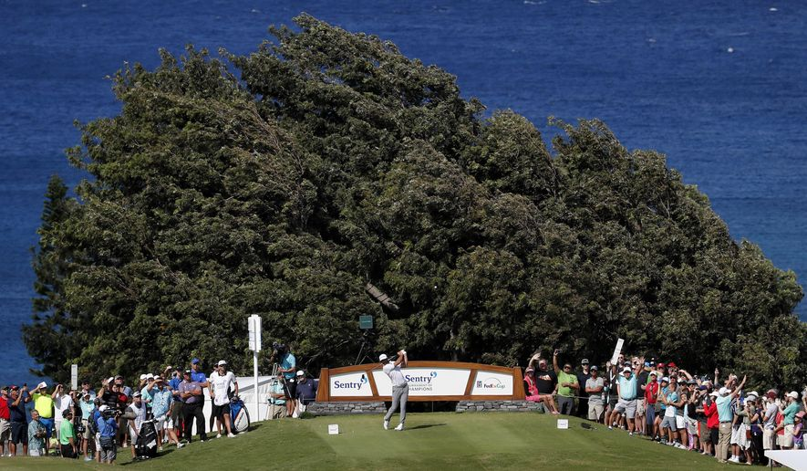 Dustin Johnson plays his shot from the 14th tee during the third round of the Tournament of Champions golf event, Saturday, Jan. 6, 2018, at Kapalua Plantation Course in Kapalua, Hawaii. (AP Photo/Matt York)