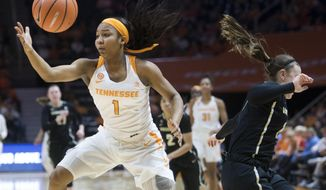 Tennessee's Anastasia Hayes gets the ball while defended by Vanderbilt's Autumn Newby during an NCAA college basketball game in Knoxville, Tenn., on Sunday, Jan. 7, 2018. (Saul Young/Knoxville News Sentinel via AP)