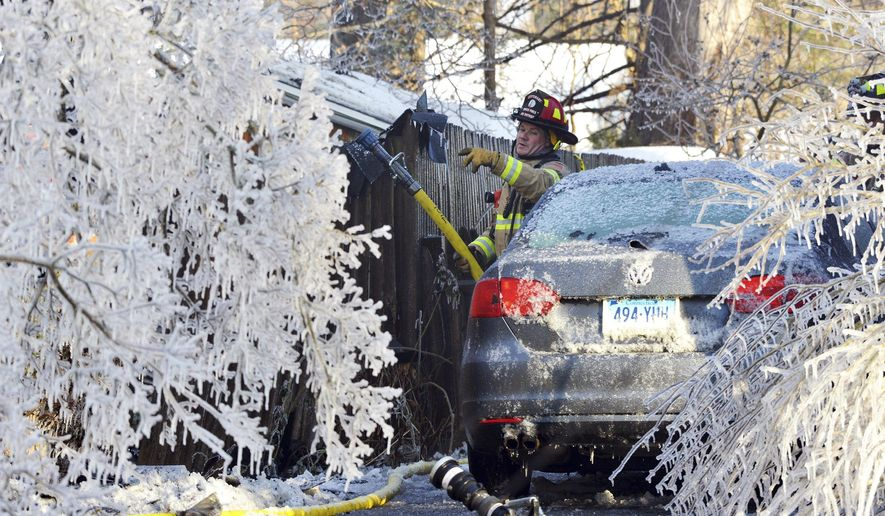 FILE - In this Jan. 5, 2018, file photo, a firefighter from the Longmeadow Fire Department battles a house fire in Longmeadow, Mass. Firefighters battling blazes in the extreme cold are faced with treacherous conditions, frozen hydrants and slick surfaces that make an already difficult job even harder. Departments in colder climates prepare months ahead for the coming freeze, readying equipment and changing how they approach fires in the coldest months. (Dave Roback/The Republican via AP, File)
