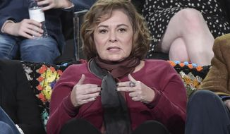 """Roseanne Barr participates in the """"Roseanne"""" panel during the Disney/ABC Television Critics Association Winter Press Tour on Monday, Jan. 8, 2018, in Pasadena, Calif. (Photo by Richard Shotwell/Invision/AP)"""
