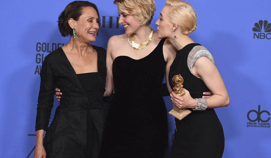 "Laurie Metcalf, from left, Greta Gerwig and Saoirse Ronan, winners of the award for best motion picture - musical or comedy for ""Lady Bird"" pose in the press room at the 75th annual Golden Globe Awards at the Beverly Hilton Hotel on Sunday, Jan. 7, 2018, in Beverly Hills, Calif. Ronan also accepted the award for best performance by an actress in a motion picture - musical or comedy for ""Lady Bird"". (Photo by Jordan Strauss/Invision/AP)"