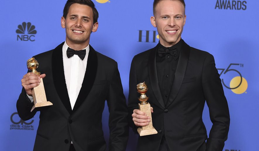 "Benj Pasek, left, and Justin Paul pose in the press room with the award for best original song - motion picture for ""This Is Me"" from ""The Greatest Showman"" the 75th annual Golden Globe Awards at the Beverly Hilton Hotel on Sunday, Jan. 7, 2018, in Beverly Hills, Calif. (Photo by Jordan Strauss/Invision/AP)"