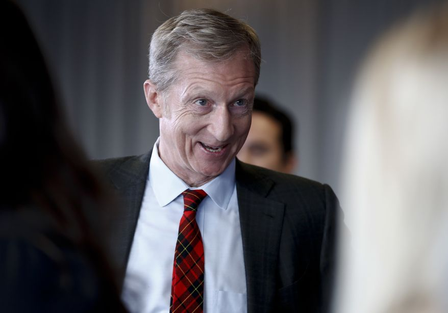 Billionaire activist Tom Steyer turns to people standing behind him before taking questions during a news conference in Washington, Monday, Jan. 8, 2018. (AP Photo/Carolyn Kaster)
