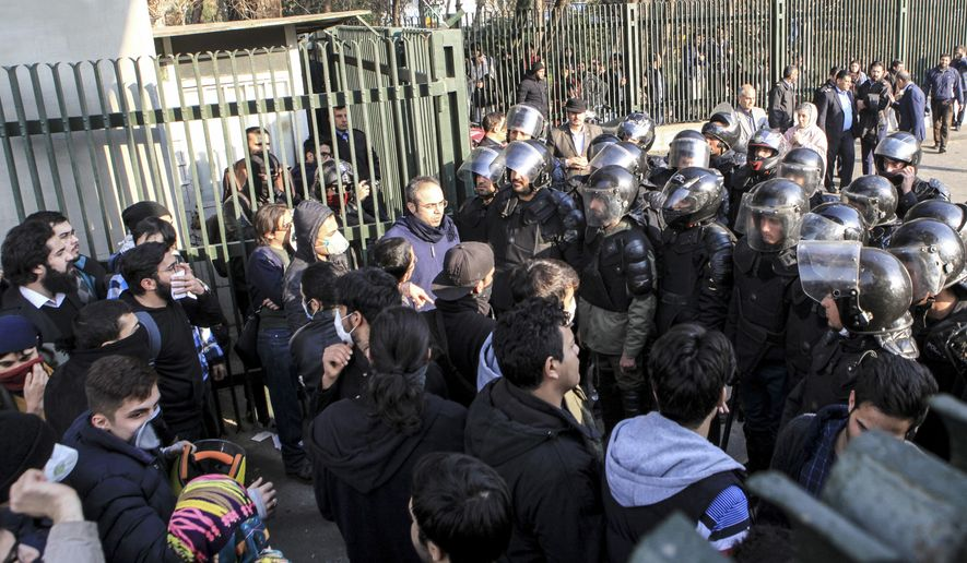In this Dec. 30, 2017, file photo taken by an individual not employed by The Associated Press and obtained by the AP outside Iran, anti-riot Iranian police prevent university students to join other protesters over Iran's weak economy, in Tehran, Iran. New unrest in Iran over the past 10 days appears to be waning, but anger over the economy persists. (AP Photo, File)