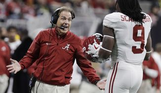 Alabama head coach Nick Saban talks to Bo Scarbrough during the first half of the NCAA college football playoff championship game against Georgia Monday, Jan. 8, 2018, in Atlanta. (AP Photo/David J. Phillip)