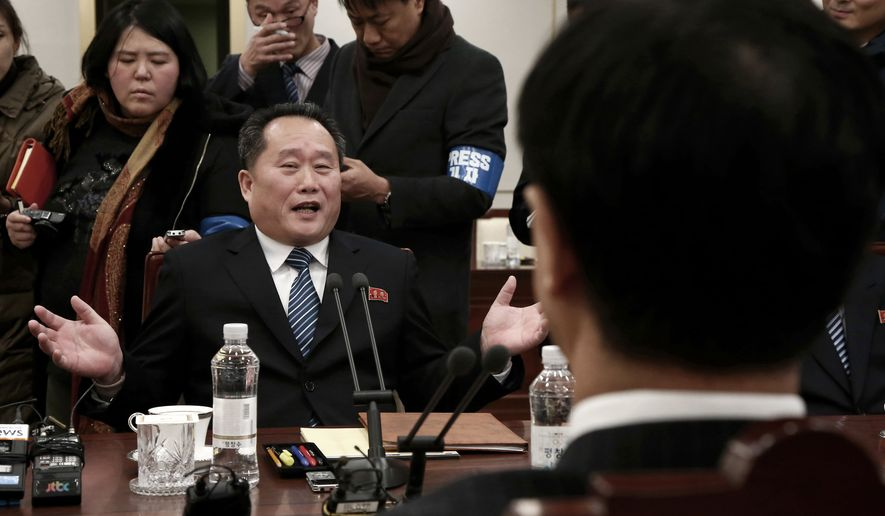 Head of North Korean delegation Ri Son Gwon speaks to South Korean Unification Cho Myoung-gyon, right, during their meeting at the Panmunjom in the Demilitarized Zone in Paju, South Korea, Tuesday, Jan. 9, 2018. Senior officials from the rival Koreas said Tuesday they would try to achieve a breakthrough in their long-strained ties as they sat for rare talks at the border to discuss how to cooperate in next month's Winter Olympics in the South and other issues. (Korea Pool via AP)