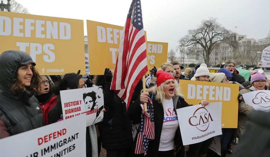 CASA de Maryland, an immigration advocacy and assistance organization, holds a rally in Lafayette Park, across from the White House in Washington, Monday, Jan. 8, 2018, in reaction to the announcement regarding Temporary Protective Status for people from El Salvador. The Trump administration is ending special protections for Salvadoran immigrants, forcing nearly 200,000 to leave the U.S. by September 2019 or face deportation. El Salvador is the fourth country whose citizens have lost Temporary Protected Status under President Donald Trump, and they have been, by far, the largest beneficiaries of the program, which provides humanitarian relief for foreigners whose countries are hit with natural disasters or other strife. (AP Photo/Pablo Martinez Monsivais)