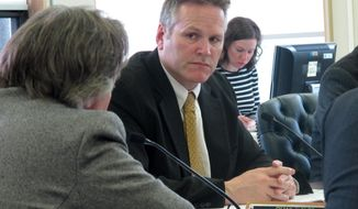 FILE - In this Tuesday, May 17, 2016 file photo Alaska state Sen. Mike Dunleavy listens during a Senate Finance Committee meeting on an oil and gas tax credit rewrite, in Juneau, Alaska. Dunleavy says he will resign his seat to focus on running for governor this year. (AP Photo/Becky Bohrer,File)