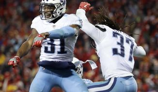Tennessee Titans safety Kevin Byard (31) and safety Johnathan Cyprien (37) celebrate after Cyprien broke up a pass to Kansas City Chiefs wide receiver Albert Wilson during the second half of an NFL wild-card playoff football game, in Kansas City, Mo., Saturday, Jan. 6, 2018. (AP Photo/Charlie Riedel)