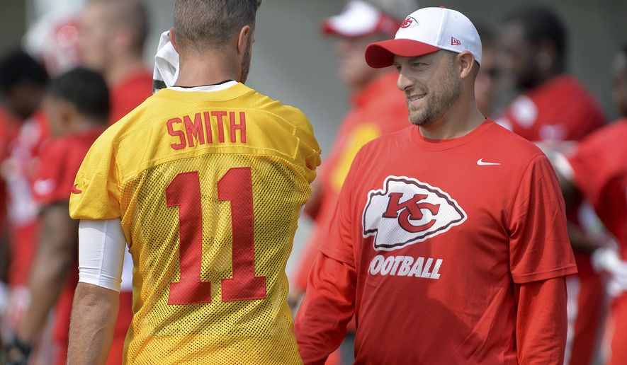 FILE - In this Aug. 5, 2015, file photo, Kansas City Chiefs quarterback Alex Smith talks with quarterbacks coach Matt Nagy at NFL football training camp in St. Joseph, Mo. Chicago Bears general manager Ryan Pace announced the hiring of Matt Nagy as the NFL football team's 16th head coach, Monday, Jan. 8, 2018.(Andrew Carpenean/The St. Joseph News-Press via AP, File)