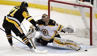 Boston Bruins goaltender Tuukka Rask (40) makes the save on a shot by Pittsburgh Penguins' Evgeni Malkin (71) in the third period of an NHL hockey game in Pittsburgh, Sunday, Jan. 7, 2018. The Penguins won 6-5 in overtime. (AP Photo/Gene J. Puskar)