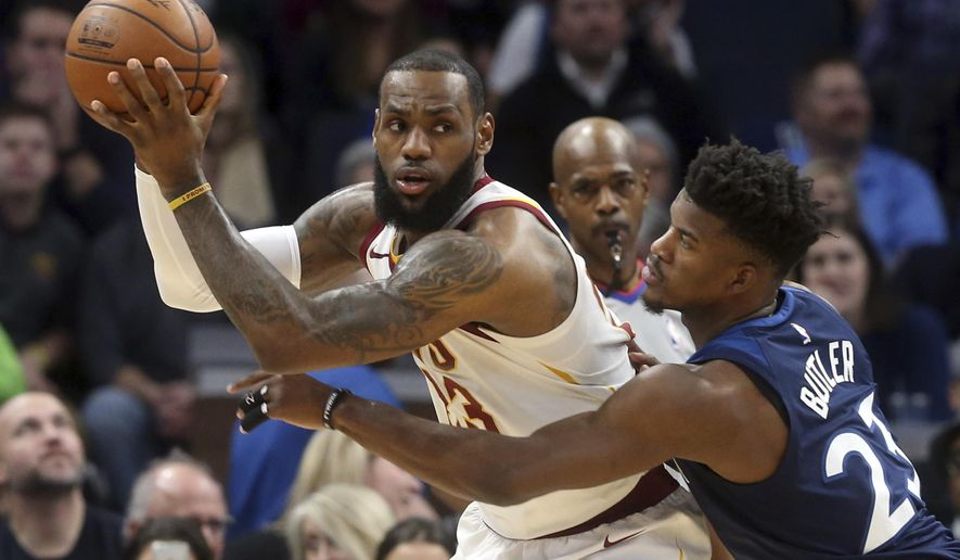Cleveland Cavaliers' LeBron James, left, looks for help as Minnesota Timberwolves' Andrew Wiggins defends in the first half of an NBA basketball game Monday, Jan. 8, 2018, in Minneapolis. (AP Photo/Jim Mone)