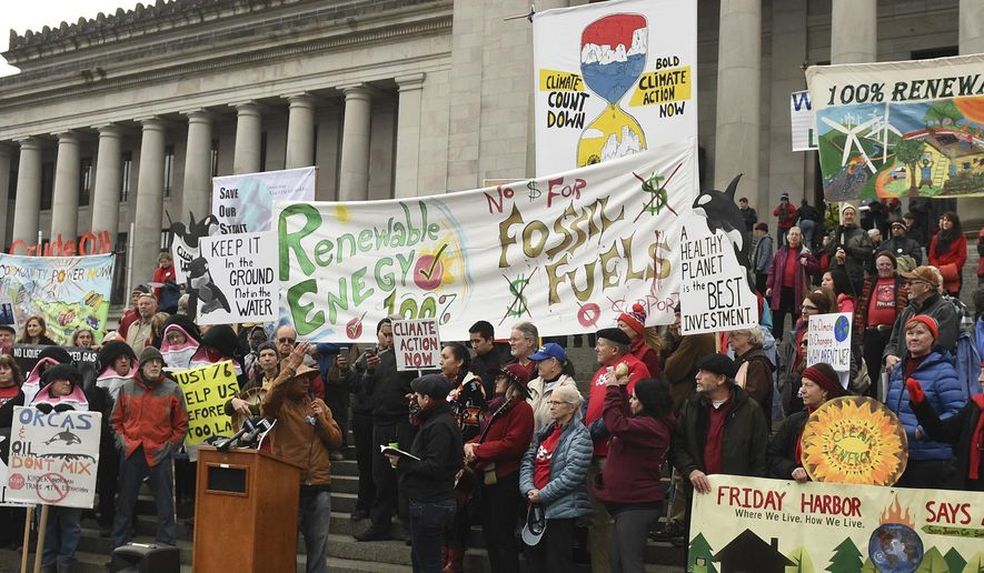 On the opening day of the 2018 Legislative Session in Olympia, Wash. on Monday, Jan. 8. 2018 speaker Paul Che oke ten Wagner from the Sanich First Nations extols a crowd of several hundred supporters to protect the environment for the sake of children and future generations during the Climate Countdown Day 1 rally on the steps of the Capitol. (Steve Bloom/The Olympian via AP)