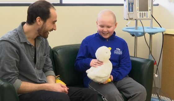 """In this undated photo made from video, 12-year-old cancer patient Ethan Daniels at a medical facility in Atlanta speaks with Aaron Horowitz, co-founder and CEO of Sproutel, who designed """"My Special Aflac Duck"""" to promote emotional well-being by helping children living with cancer develop a sense of control and manage stress through interactive technology. (AP Photo/Marina Hutchinson) ** FILE **"""