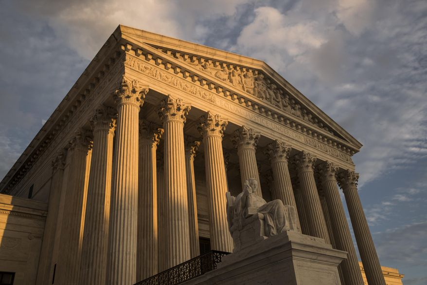 In this Oct. 10, 2017 photo, The Supreme Court in Washington is seen at sunset.  The Supreme Court is refusing to intervene in a legal fight over a Mississippi law that lets government workers and private business people cite their own religious beliefs to deny services to LGBT people. Opponents say the law could lead to discrimination against those who support same-sex marriage.  (AP Photo/J. Scott Applewhite)