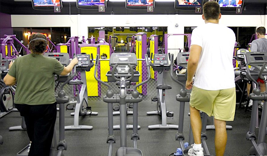 A typical gym like this features built-in entertainment offerings on its equipment.  Life Time Athletics, a national fitness chain, has now banned cable news from the mix at its 128 centers.  (AP Photo by Gerry Broome)