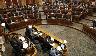 Iowa House Speaker Linda Upmeyer, left, delivers her opening remarks on the opening day of the Iowa Legislature, Monday, Jan. 8, 2018, at the Statehouse in Des Moines, Iowa. (AP Photo/Charlie Neibergall)