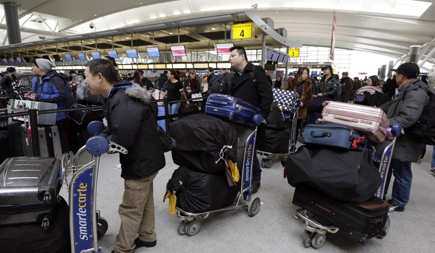 "Passengers at New York's John F. Kennedy Airport Terminal 4 wait for flights, Monday, Jan. 8, 2018. The Port Authority of New York and New Jersey said Monday it will investigate the water pipe break that added to the weather-related delays at Kennedy Airport and will ""hold all responsible parties accountable."" (AP Photo/Richard Drew)"