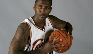 FILE - In this Sept. 29, 2008, file photo, Cleveland Cavaliers' Lorenzen Wright poses at the team's NBA basketball media day in Independence, Ohio. The ex-wife of former NBA player Lorenzen Wright will not fight authorities' attempt to send her from California to Tennessee, where she's charged with killing him nearly eight years ago. The Desert Sun newspaper reports that Sherra Wright briefly appeared in Riverside County Superior Court on Monday, Jan. 8, 2018, agreed to go back to Tennessee to face first-degree murder charges.(AP Photo/Mark Duncan, file)