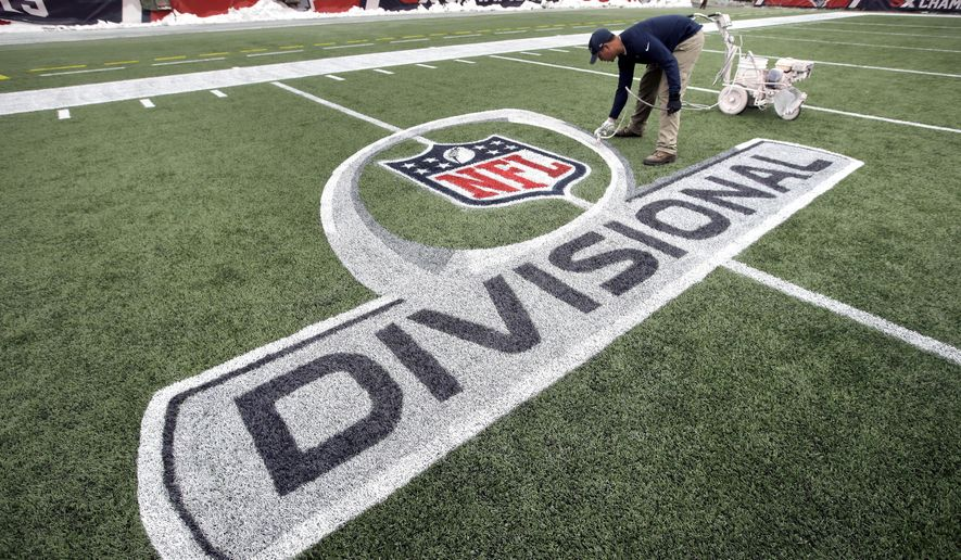 Gillette Stadium field crew foreman Joshua Bergeron, of Providence, R.I., applies paint to an NFL football AFC championship divisional round logo, Monday, Jan. 8, 2018, on the field at Gillette Stadium in Foxborough, Mass. The New England Patriots are scheduled to host the Tennessee Titans in the AFC divisional round game, Saturday, Jan. 13, 2018, in Foxborough. (AP Photo/Steven Senne)