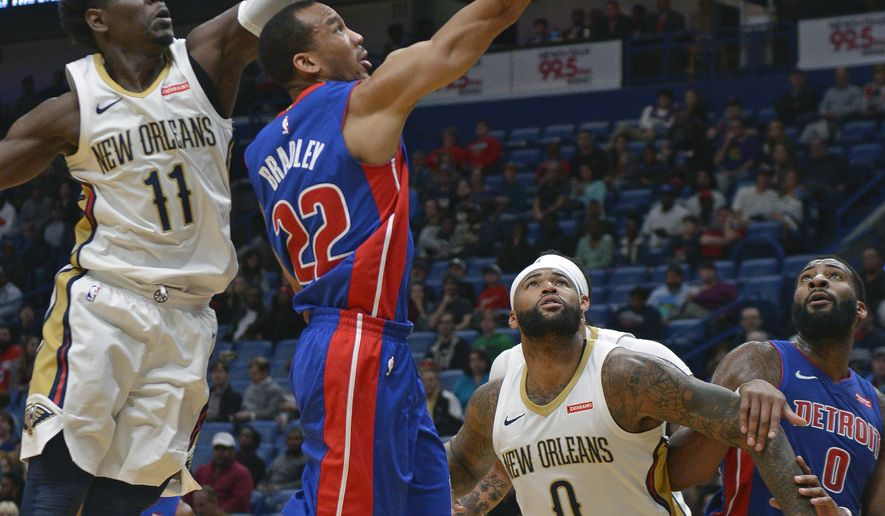 Detroit Pistons guard Avery Bradley (22) drives to the basket against New Orleans Pelicans guard Jrue Holiday (11) in the first half of an NBA basketball game in New Orleans, Monday, Jan. 8, 2018. (AP Photo/Veronica Dominach)