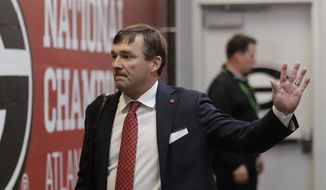 Georgia head coach Kirby Smart waves as the team arrives before the NCAA college football playoff championship game against Alabama Monday, Jan. 8, 2018, in Atlanta. (AP Photo/John Bazemore)