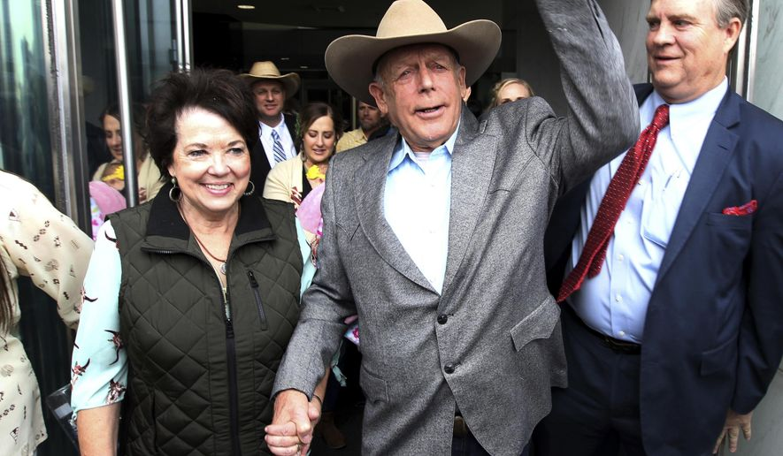 Cliven Bundy walks out of federal court with his wife Carol on Monday, Jan. 8, 2018, in Las Vegas, after a judge dismissed criminal charges against him and his sons accused of leading an armed uprising against federal authorities in 2014. (K.M. Cannon/Las Vegas Review-Journal via AP)