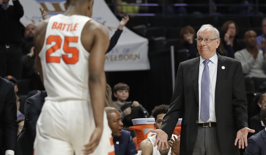 Syracuse head coach Jim Boeheim, right, shows his frustration after Tyus Battle (25) turned the ball over against Wake Forest during the second half of an NCAA college basketball game in Winston-Salem, N.C., Wednesday, Jan. 3, 2018. (AP Photo/Chuck Burton)