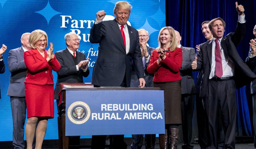 President Donald Trump pumps his fist after signing an executive order and a memorandum on rural broadband access at the American Farm Bureau Federation's Annual Convention at the Gaylord Opryland Resort and Convention Center, Monday, Jan. 8, 2018, in Nashville, Tenn. (AP Photo/Andrew Harnik)