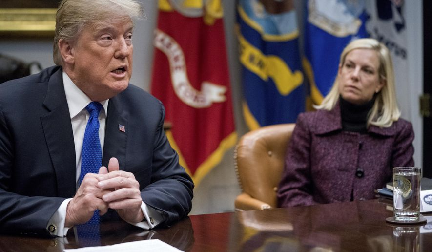 President Donald Trump, accompanied by Secretary of Homeland Security Kirstjen Nielsen, speaks during a meeting with Republican senators on immigration in the Roosevelt Room at the White House in Washington on  Jan. 4, 2018. (Associated Press) **FILE**