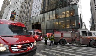 New York City Fire Department vehicles sit on Fifth Avenue in front of Trump Tower, in New York, Monday, Jan. 8, 2018. The department said a fire started around 7 a.m. Monday in the heating and air conditioning system of the building. (AP Photo/Richard Drew)