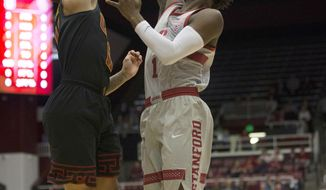 Stanford's Daejon Davis (1) shoots over Southern California's Jordan McLaughlin (11) during the first half of an NCAA college basketball game, Sunday, Jan. 7, 2018, in Stanford, Calif. (AP Photo/D. Ross Cameron)