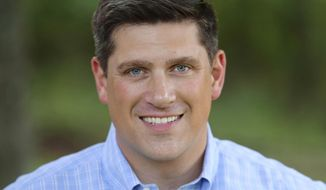 This undated file photo provided by Kevin Nicholson, shows Nicholson, a former Marine and past president of a national college Democratic group, who posted online July 26, 2017, that he had launched a Republican bid for the U.S. Senate in Wisconsin. A campaign spokesperson said Monday, Jan. 8, 2018, that Nicholson has raised twice as much as his primary challenger Leah Vukmir in the last three months of 2017. The winner of the GOP primary will face Democratic Sen. Tammy Baldwin in November. (Kevin Nicholson via AP, File)
