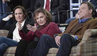 """Laurie Metcalf, left, Roseanne Barr and John Goodman participate in the """"Roseanne"""" panel during the Disney/ABC Television Critics Association Winter Press Tour on Monday, Jan. 8, 2018, in Pasadena, Calif. (Photo by Richard Shotwell/Invision/AP)"""