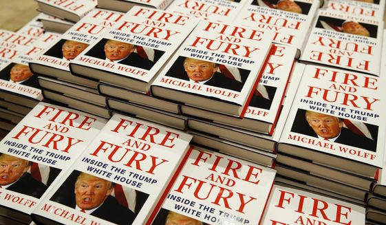 "Copies of Michael Wolff's ""Fire and Fury: Inside the Trump White House"" are on display as they go on sale at a bookshop, in London, Tuesday, Jan. 9, 2018. A trade magazine is reporting that over 1 million orders for the book have been placed in the United States alone. (AP Photo/Alastair Grant)"