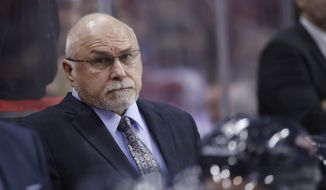 Then-Washington Capitals head coach Barry Trotz stands in the bench area in the third period of an NHL hockey game against the Vancouver Canucks, Tuesday, Jan. 9, 2018, in Washington. The Capitals won 3-1. (AP Photo/Alex Brandon) ** FILE **
