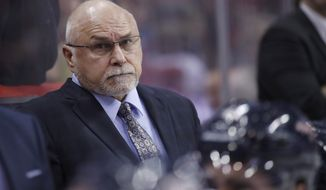 Washington Capitals head coach Barry Trotz stands in the bench area in the third period of an NHL hockey game against the Vancouver Canucks, Tuesday, Jan. 9, 2018, in Washington. The Capitals won 3-1. (AP Photo/Alex Brandon)