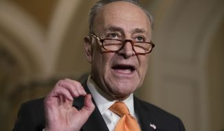 Senate Minority Leader Chuck Schumer, D-N.Y., speaks to reporters following a weekly, closed-door strategy session, at the Capitol in Washington, Tuesday, Jan. 9, 2018. (AP Photo/J. Scott Applewhite)