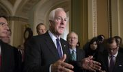Senate Majority Whip John Cornyn, R-Texas, joined from by, Sen. John Barrasso, R-Wyo., Sen. Roy Blunt, R-Mo., Sen. John Thune, R-S.D., and Senate Majority Leader Mitch McConnell, R-Ky., speaks to reporters following a weekly, closed-door strategy session, at the Capitol in Washington, Tuesday, Jan. 9, 2018. (AP Photo/J. Scott Applewhite) ** FILE **