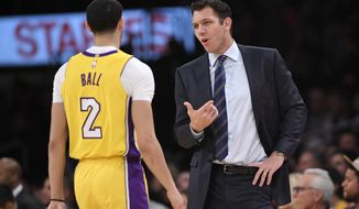 Los Angeles Lakers coach Luke Walton, right, talks with guard Lonzo Ball during the first half of the team's NBA basketball game against the Sacramento Kings, Tuesday, Jan. 9, 2018, in Los Angeles. (AP Photo/Mark J. Terrill)