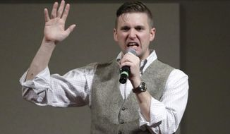 In this Dec. 6, 2016, file photo, Richard Spencer speaks at the Texas A&M University campus in College Station, Texas. Spencer's campus tour organizer is suing the University of Cincinnati's president, saying the school wouldn't rent space for Spencer to speak on campus unless a nearly $11,000 security fee was paid. An attorney for Spencer and the organizer says requiring such payment because a speaker is controversial or prompts hostile reaction is discriminatory and unconstitutional. (AP Photo/David J. Phillip, File)