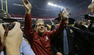Alabama head coach Nick Saban celebrates after overtime of the NCAA college football playoff championship game against Georgia Monday, Jan. 8, 2018, in Atlanta. Alabama won 26-23. (AP Photo/David J. Phillip)