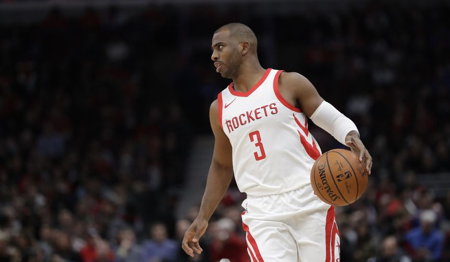 Houston Rockets' Chris Paul sets up a play during the first half of an NBA basketball game Monday, Jan. 8, 2018, in Chicago. (AP Photo/Charles Rex Arbogast)