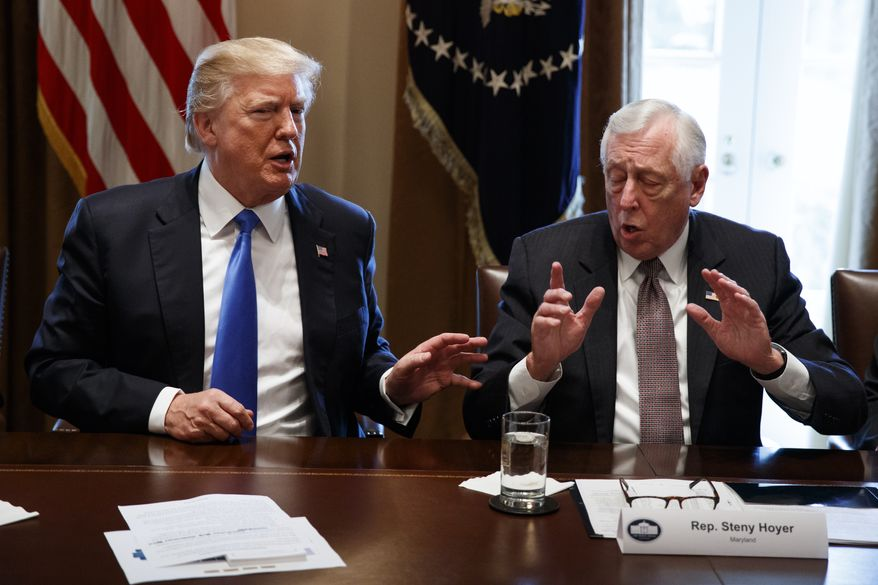 President Donald Trump speaks with Rep. Steny Hoyer, D-Md., during a meeting with lawmakers on immigration policy, Tuesday, Jan. 9, 2018, in Washington. (AP Photo/Evan Vucci)