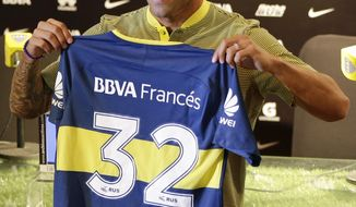 Carlos Tevez shows his Boca Juniors jersey, during his presentation as a new member of the team in Cardales, Argentina, Tuesday, Jan. 9, 2018. Tevez was officially presented today as part of the Boca Juniors team, for a third time in his career. (AP Photo/Natacha Pisarenko)