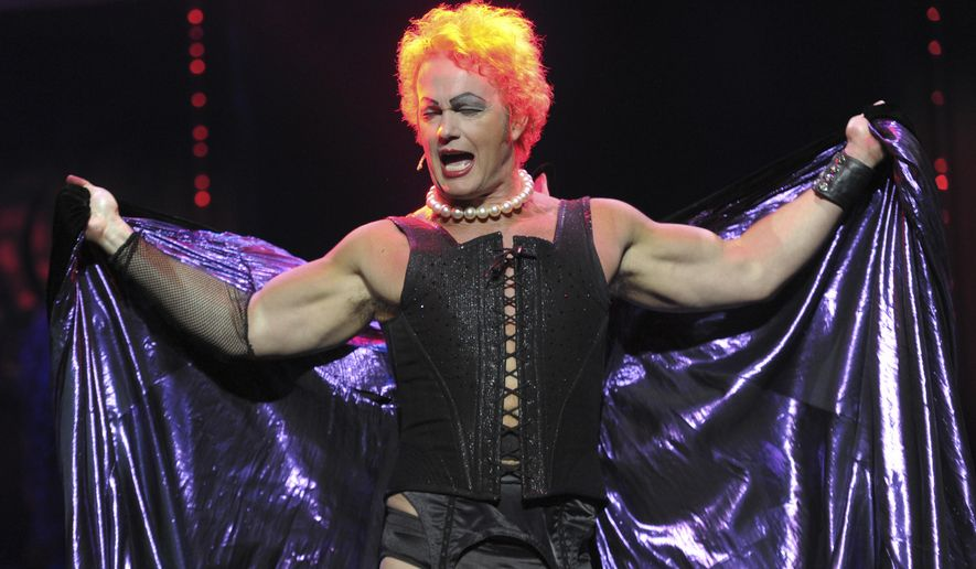"""In this April 23, 2014, photo, Craig McLachlan performs during a media call for The Rocky Horror Show at the Comedy Theatre in Melbourne, Australia. McLachlan has left a stage show and a TV series he was to star in has suspended production after three actresses of a 2014 production of the """"The Rocky Horror Show,"""" accused him of indecent assault, sexual harassment and bullying four years ago. The 52-year-old actor has denied the allegations that were first reported in the media on Monday, Jan 8, 2018. (Julian Smith/AAP Image via AP)"""