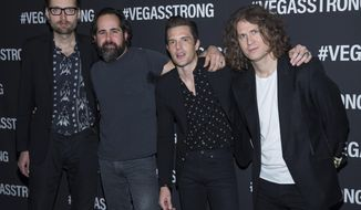 FILE - In this Dec. 1, 2017, file photo, from left, Mark Stoermer, Ronnie Vannucci, Brandon Flowers and Dave Keuning of The Killers arrive at the Vegas Strong Benefit concert at T-Mobile Arena, in Las Vegas. Eminem, The Killers, Muse, Future, Bassnectar and Sturgill Simpson lead the lineup for the Bonnaroo Music and Arts Festival this June in Tennessee. The festival announced on Tuesday, Jan. 9, 2018, their lineup for the music festival in Manchester, June 7 -10. (Photo by Eric Jamison/Invision/AP, File)