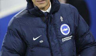 Brighton & Hove Albion manager Chris Hughton looks on during the English FA Cup, Third Round match against Crystal Palace at the AMEX Stadium in Brighton, England, Monday Jan. 8, 2018. (Gareth Fuller/PA via AP)