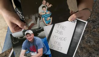 """In this photo taken Tuesday, Aug. 29, 2017, Janelle Jones, displays two undated family photos, one showing her late husband, California Correctional Officer Scott Jones, the middle photo showing her, her husband and son Tyler, then age 11, and a copy of the note left by Scott Jones after his 2011 suicide, in her home in Reno, Calif. Scott Jones, who worked at the maximum-security High Desert State prison in northeast California, committed suicide July 8, 2011, leaving a note behind saying """"The job made me do it."""" Suicides are distressingly common among California prison employees. (AP Photo/Rich Pedroncelli)"""